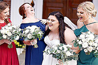 Bride and her maids laughing.